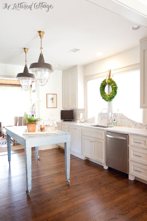 Island Pendant Lights | Ashley Gilbreath | Old House Kitchen | Marble Countertop | Boxwood Wreath