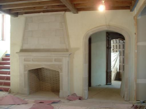 Fireplace from tudor artisans design tudor cottage for Tudor style fireplace
