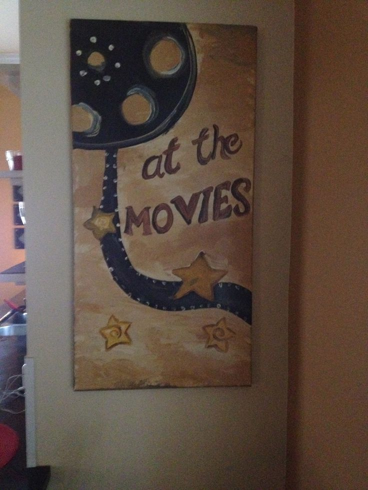 Canvas painted this to go with our wheeled popcorn cart in our media