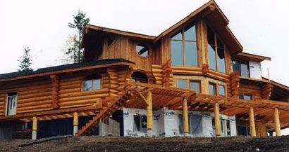 "... Lovitt's Natural Gold oil based log home stain in ""honey"" color tint"