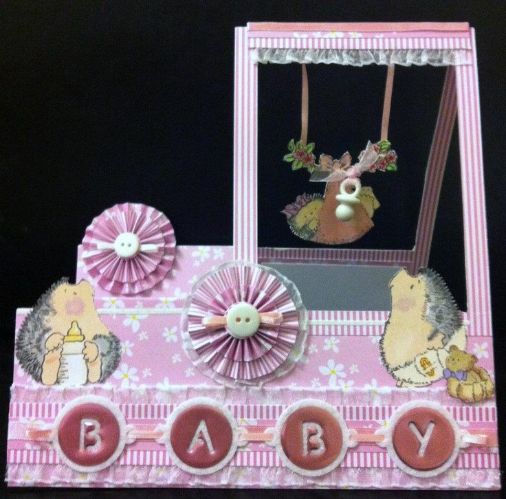 3-D baby card from Sharon Callis using Xyron.  The baby swings!