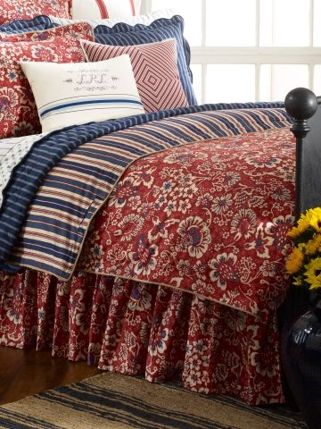 Ralph Lauren:  An unexpected pairing of bright batik sunflowers and vintage-inspired ticking stripes defines the cotton percale Villa Martine bed collection, a sophisticated embodiment of the pastoral beauty of the French countryside designed in a vibrant palette of red, white and blue.