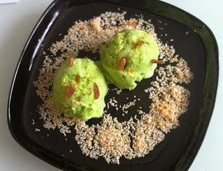 Pandan ice cream with dark palm sugar chunks and toasted coconut.