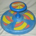 Sit and Spin  Had one. We had an orange/red one