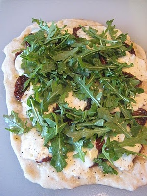 sun-dried tomato, arugula, and mozzerella pizza.. Possibly good with ...