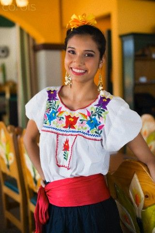 Mexican young adult woman in traditional clothing, Wellington, Palm