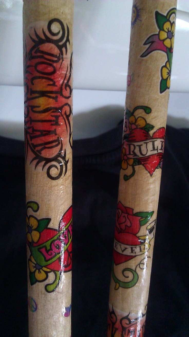 Close up of my tatted sticks. Think I will try to dye a new naked pair with water/food color before putting on the tattoos.  ;)