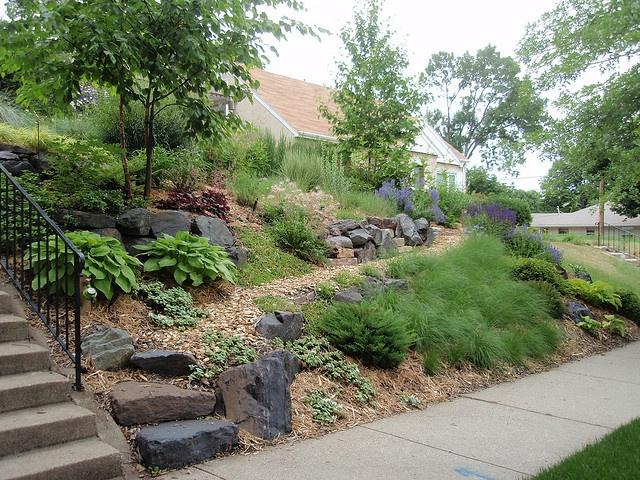 Front yard slope solution garden landscape ideas pinterest for Sloped yard solutions