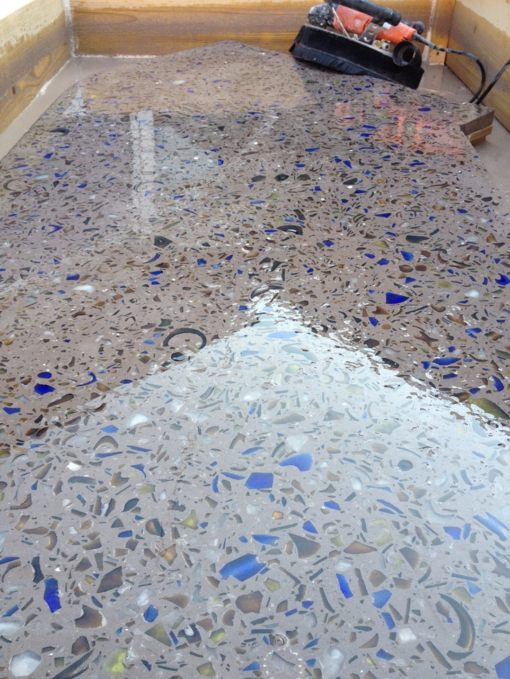 Part of a custom recycled glass/ cement countertop using a combination of wine, beer and liquor bottles