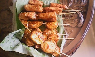 caramelized fried sweet potato and banana lumpia in bamboo sticks