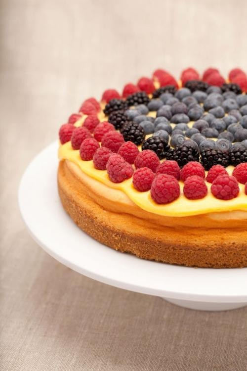 ... Vanilla Cheesecake, topped with zesty lemon curd and fresh berries