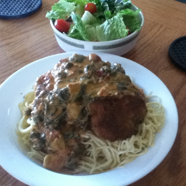 Crispy lemon chicken over fresh angel hair pasta with a spinach ...
