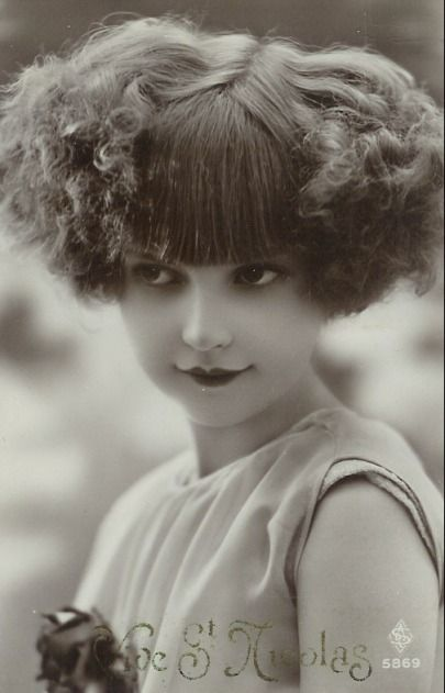 Young Girl with an incredible bobbed hairdo c.1924