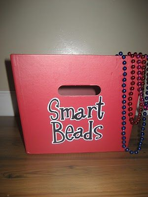 It is called Smart Beads. Whenever a student participates in class, maybe when no one else will, gets a question correct, basically just stands out in making an effort academically you tell them to get a smart bead (I bought mine at the dollar store/ 8 for $1). Then at then end of the day they trade their smart beads in for a smart slip to take home and give to their parents, they can share with them how they earned them. I love this idea because it can boost confidence academically, instead of just focusing on behavior.