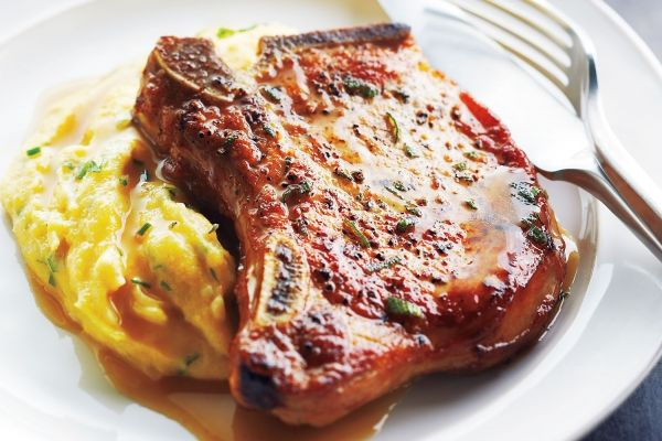 Pork Chops With Cider Sauce and Creamy Herb Polenta