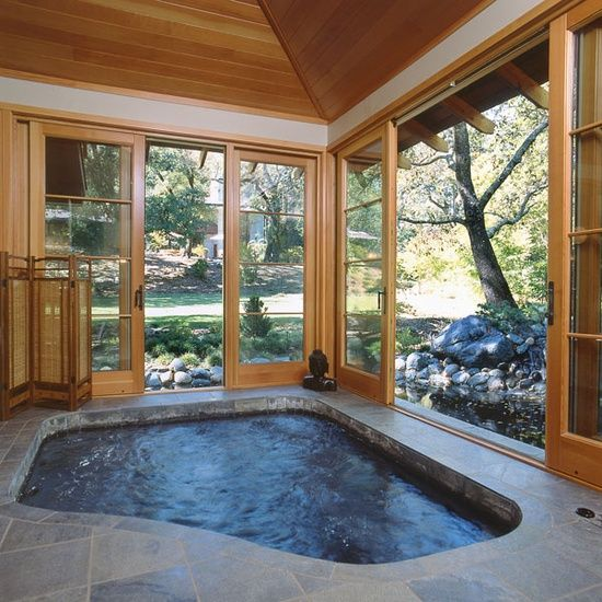 indoor hot tub in the basement in another room