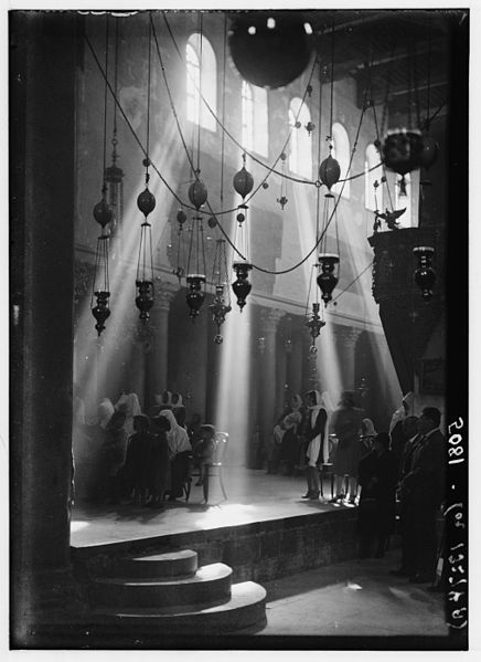 Title during christmas services in church of nativity bethlehem date