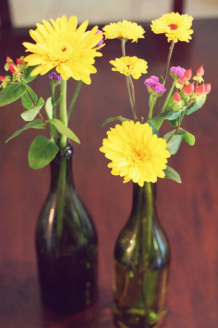 flower in wine bottle centerpieces wedding ideas