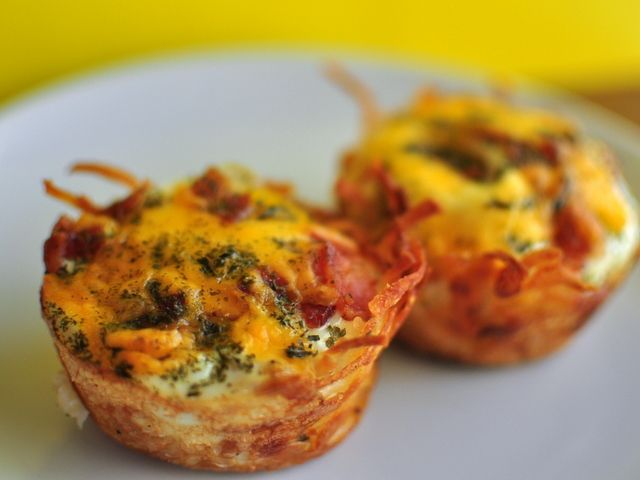 Hashbrowns and eggs baked in a muffin tin with bacon and cheese.