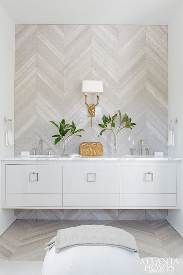 Bathroom. Incredible bathroom with gray herringbone tiled. #Bathroom #Herringbone