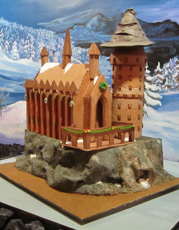 """Adult Division - """"Hogwarts Castle at Christmas."""" Materials used: gingerbread, frosting, fondant, melted hard candies."""