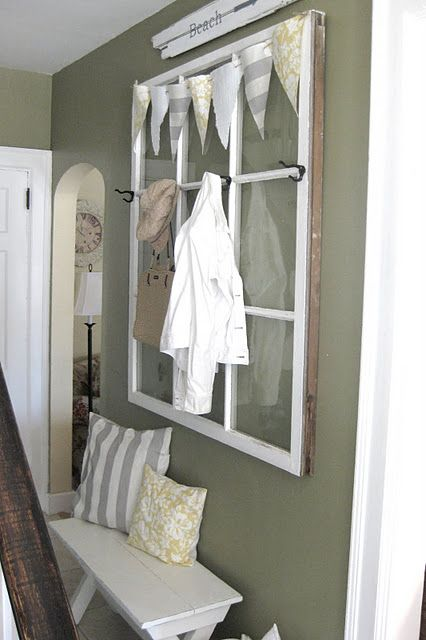 Old salvaged window turns into a coat rack