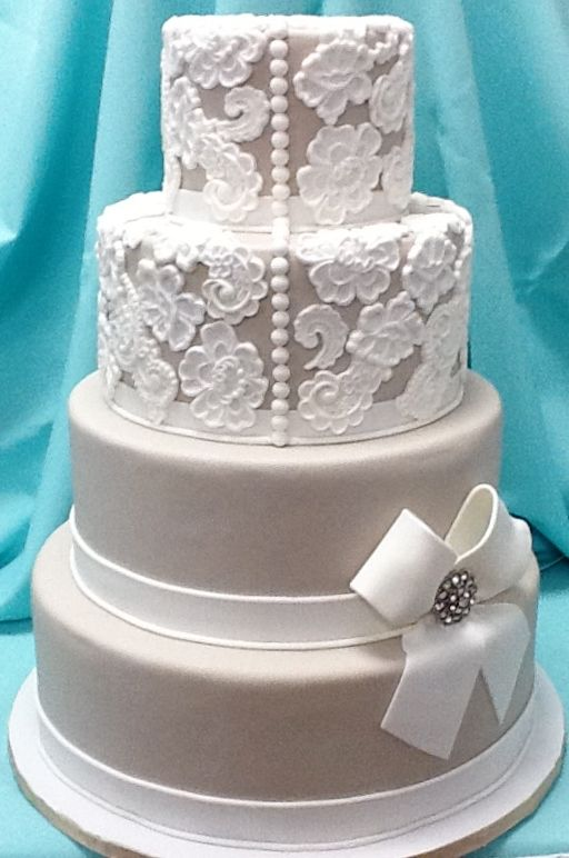 Lace Vintage Wedding Cake with buttons & bows–by Tracy Jordan at Simply Southern
