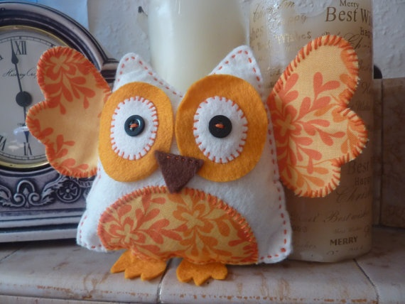Surprised owl standing on our mantelpiece