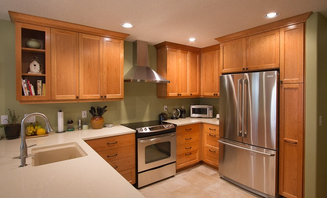 Cherry cabinets with bronze hardware and stainless steel appliances