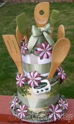 Bridal shower version of a diaper cake, with towels and kitchen utensils.