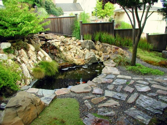 Koi pond rock garden awesome beautiful garden pinterest for Koi ponds and gardens