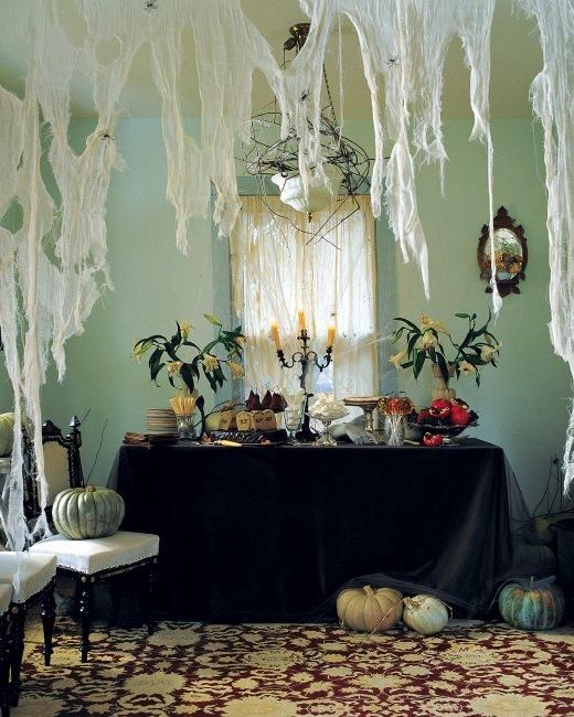 Decrepit Dwelling -- A tangle of cheesecloth spiderwebs is a sure sign that ghouls, goblins, and other spooky types have taken over the (un)living room!