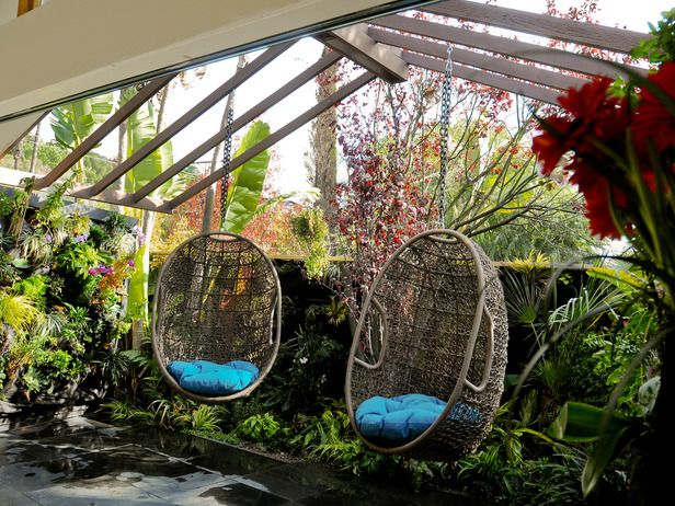 Moving doors covered with a vertical garden of orchids make up the entire back wall of Jamie Durie's bedroom.