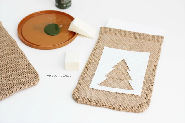 placing the stencil on the burlap bag