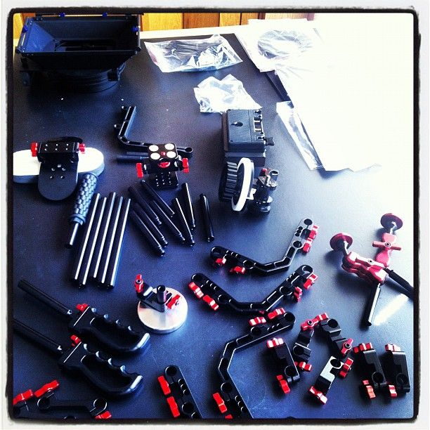 """Getting ready to put our camera rig together. It's like an adult erector set."" by @kylehufford"