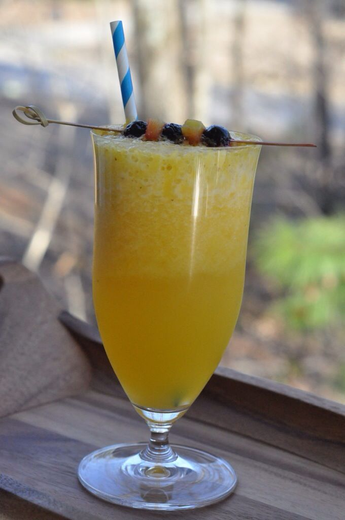Cocktail | Blueberry rum and creme de banana blend in with fresh mango ...