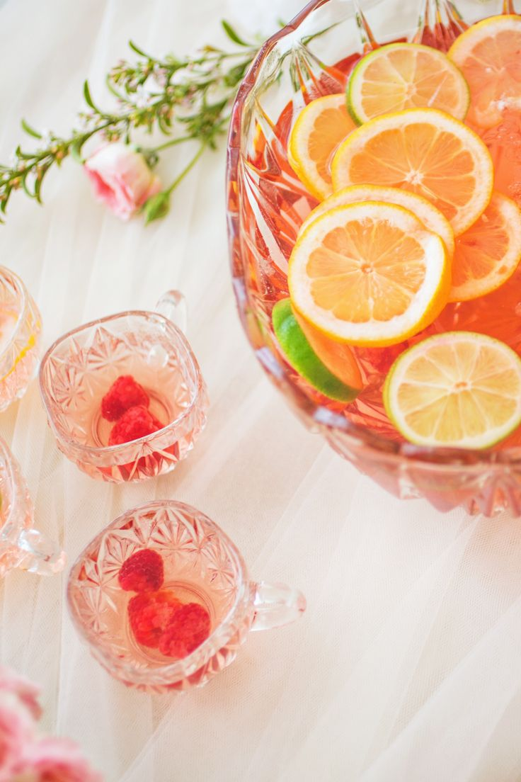 Raspberry and orange spiked punch   Photography: Je Taime Beauty - www.jetaimebeauty.com  Read More: http://www.stylemepretty.com/little-black-book-blog/2014/05/28/boudoir-bridal-shower-inspiration/