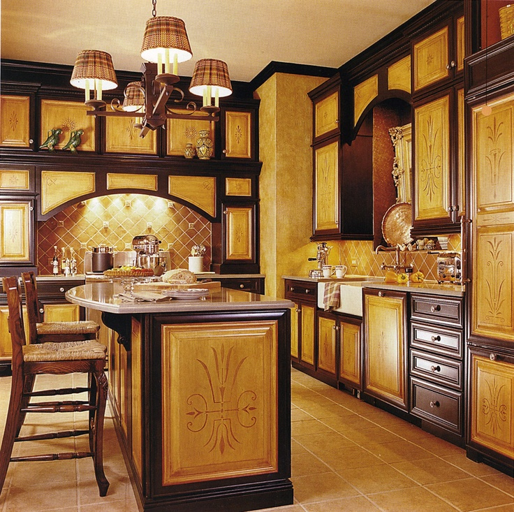 Kitchen with terracotta backsplash, black and raw sienna cabinets with