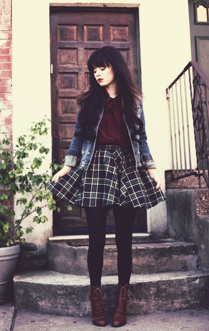 red button up top, denim jacket, checked skirt, tights, and brown boots. Just maybe with a black blazer instead