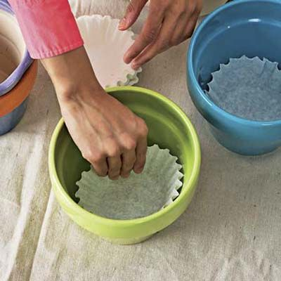 Line flowerpots with coffee filters to keep dirt from falling out.. great idea!