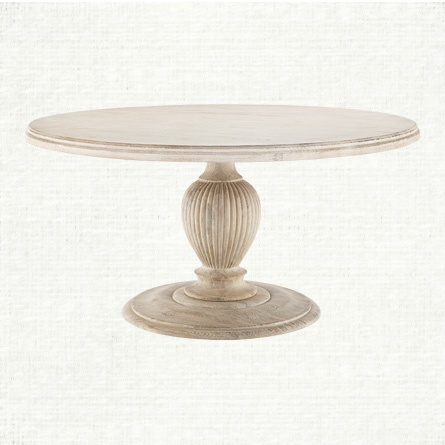 The Marvella Dining Table A Heavy Round Table With A Thick Top And A