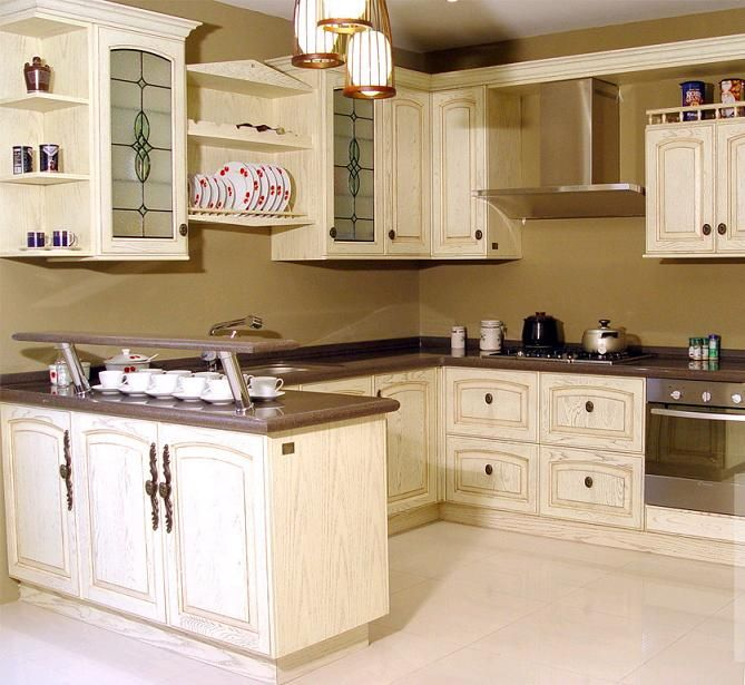 Pin by jenny corbin on kitchen pinterest for Antique ivory kitchen cabinets