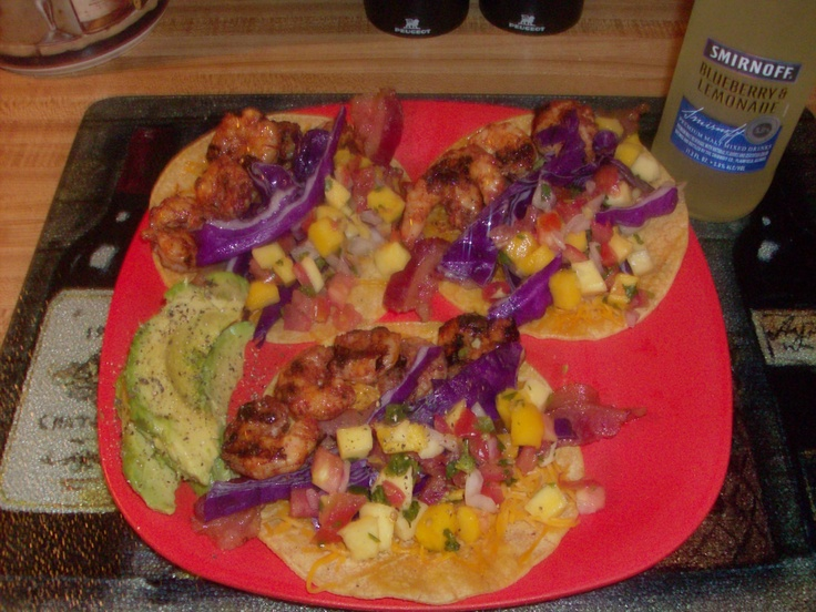 Grilled shrimp with mango salsa and avacado and purple cabbage on corn ...