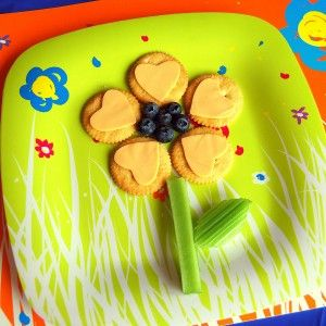 Make mealtime fun with Flower Food! Use a heart shaped cookie cutter to cut the cheese and place it on Ritz crackers. Cut the celery for the stem and leaf and arrange to wow your little one...