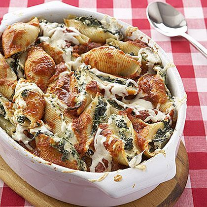 the shells with a cheese spinach mixture cover with spaghetti sauce ...