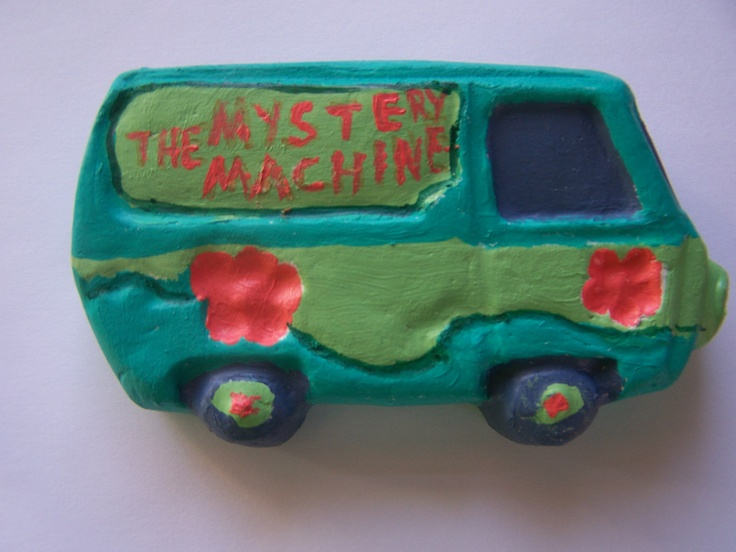 Molded using air dry clay and painted with acrylics. It also has a