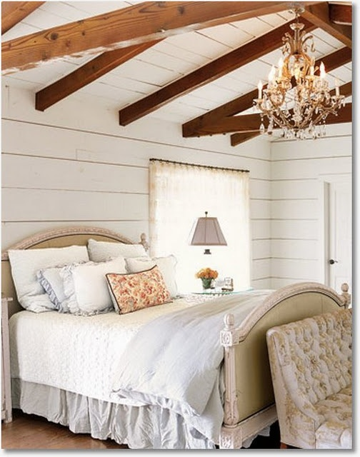 Love the exposed beams and the walls. And the bedding. And the pillows.
