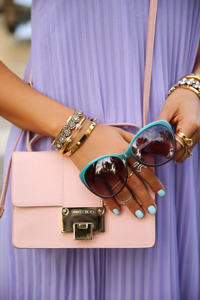 Purple pleated dress + Jimmy Choo bag.