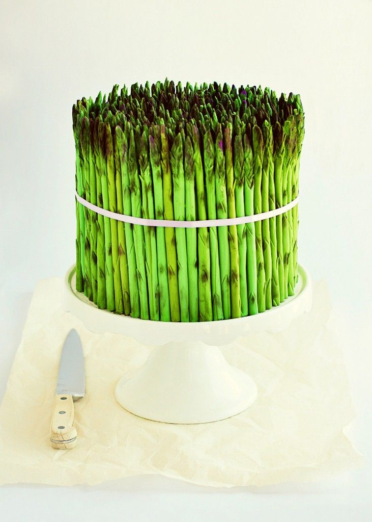 Looks like asparagus, but it is actually a cake covered in fondant asparagus!