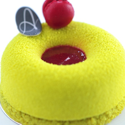 ... Pistachio Mousse, Pistachio Financier, Sour Cherry Jelly topped with a